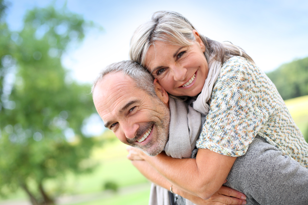 Older couple embracing in park