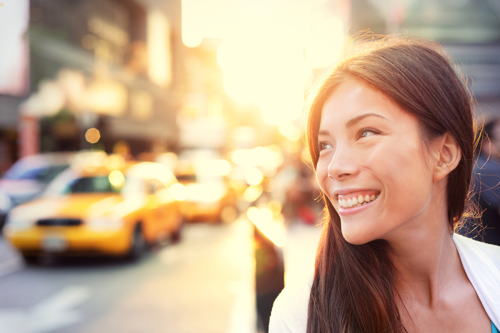 Happy woman in sunny downtown area