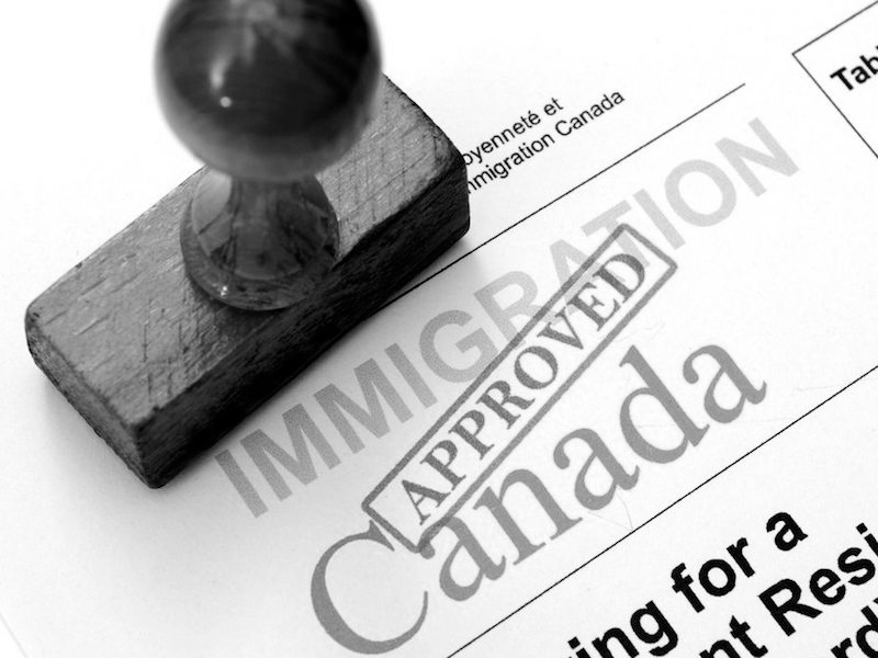 One Immigration approved documents and stamp